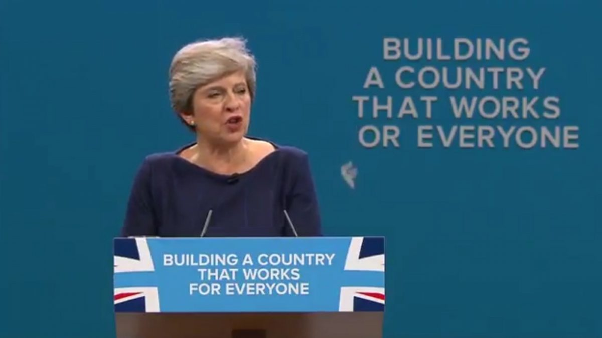 conservative-party-slogan-sign-falls-apart-during-disastrous-theresa-may-speech-1200x675.jpg